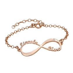 Ruusukullattu Infinity rannekoru nimillä ja timantilla product photo