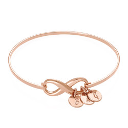 Infinity Bangle Bracelet with Initial Charms in Rose Gold Plating product photo