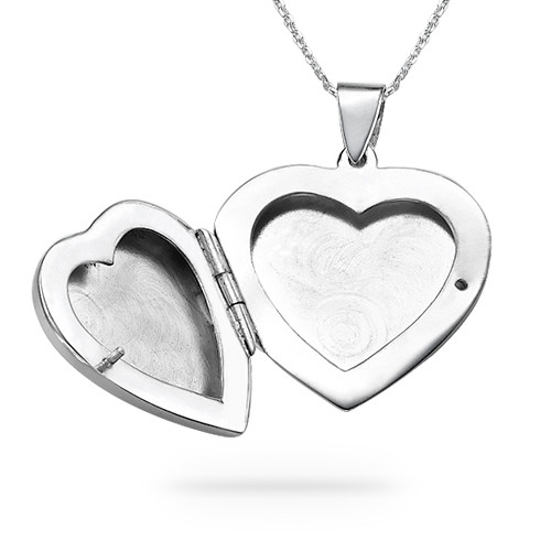 portfolio locket engraved with compass engraving silver lockets