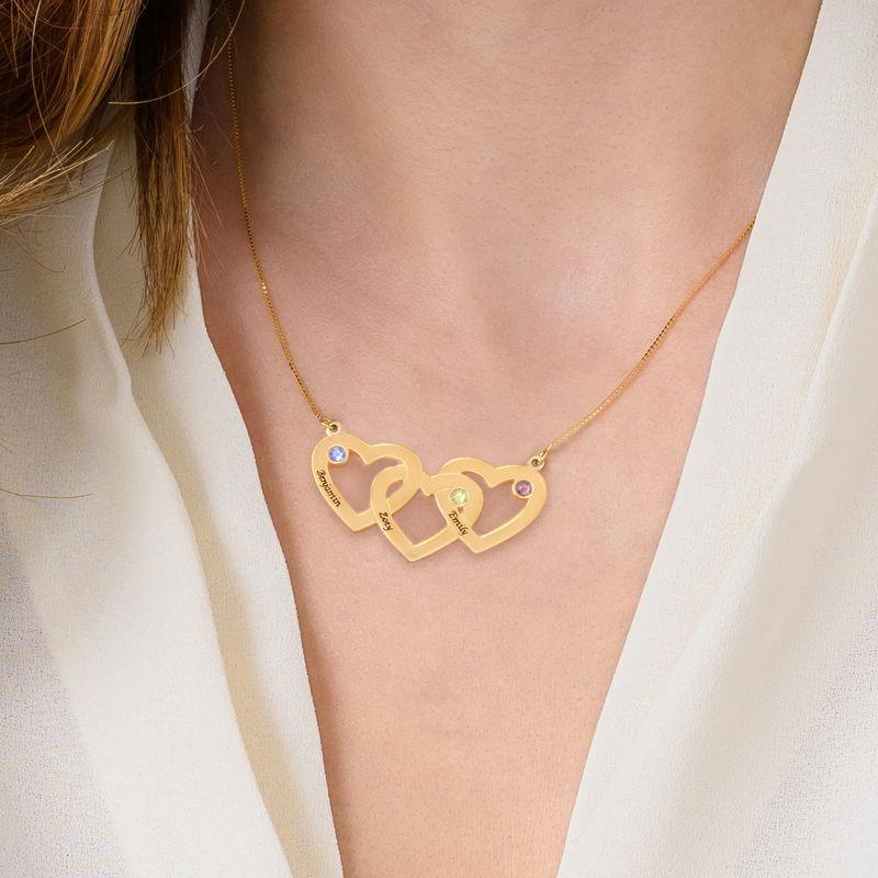 Collar Triple Corazón entrelazado con  piedras en oro de 10K - 1