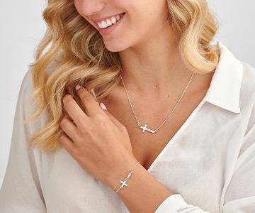 Significado del colgante con cruz horizontal