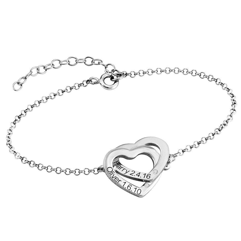 Sterling zilveren armband met ineengestrengelde harten met diamanten