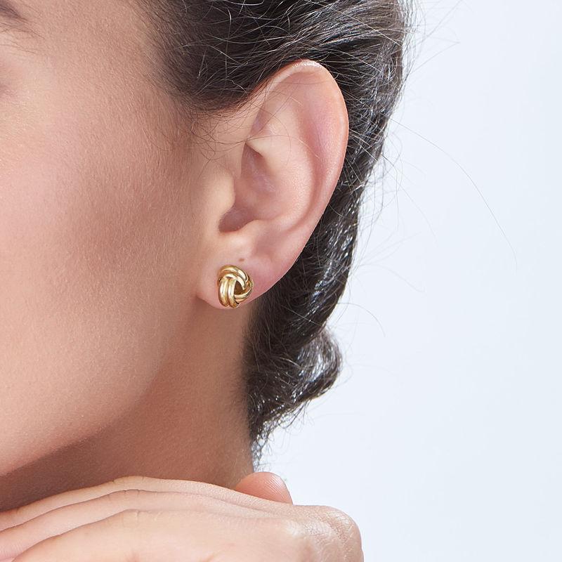 Vergulde oorstekers met liefdesknoop - 1