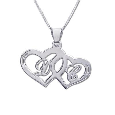 Hjertesmykke med bokstaver i sølv