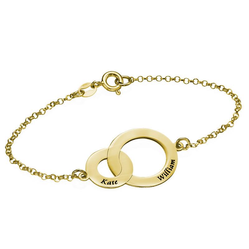 Sammenflettet sirkelarmbånd i gullbelegg