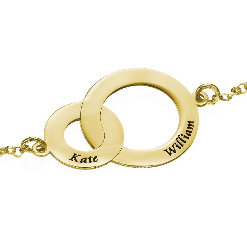 Sammenflettet sirkelarmbånd i gullbelegg - 1