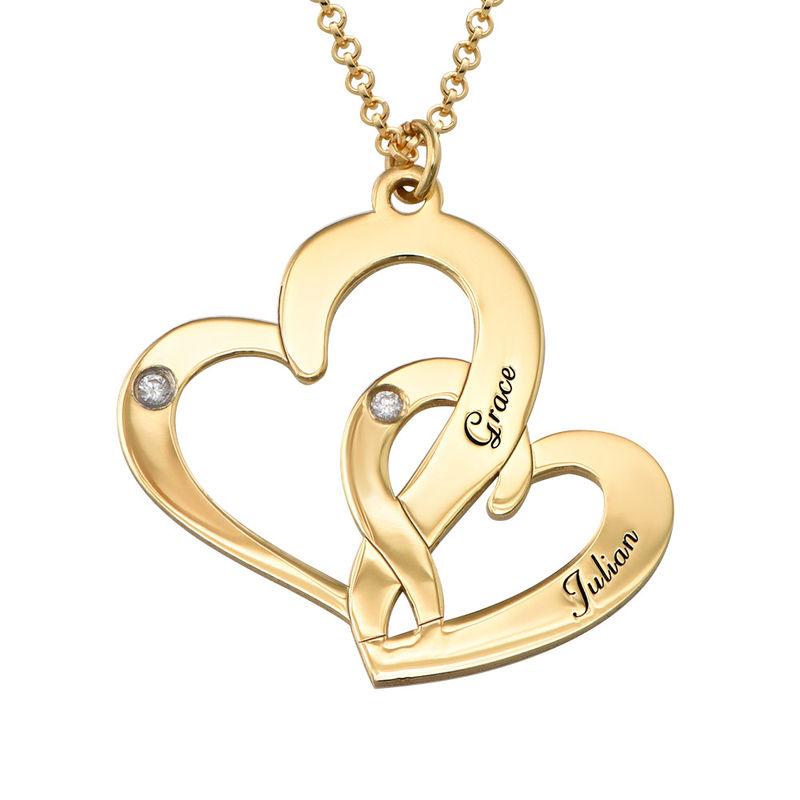 Gullbelagt inngravert smykke med to hjerter og diamanter