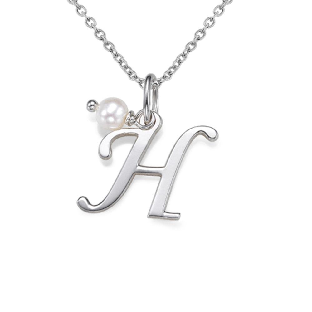 Initialsmykke med fødselsstein i sølv