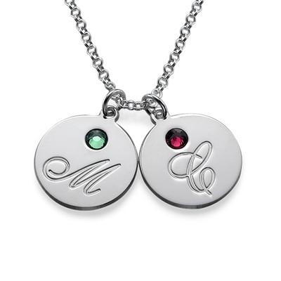 Mammasmykke med bokstaver og fødselssein i sølv