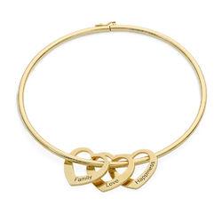 Bangle-armbånd med hjerteformede charms i 18k gullbelegg product photo