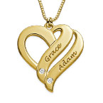 Halskjede med to hjerter og diamanter i gullbelegg